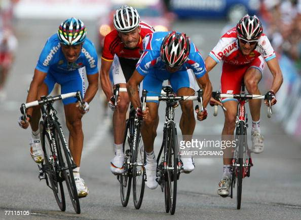 Italy's Paolo Bettini Germany Stefan Schumacher Russia's Alexandr Kolobnev and Luxembourg's Frank Schleck sprint in the men's road race during the...
