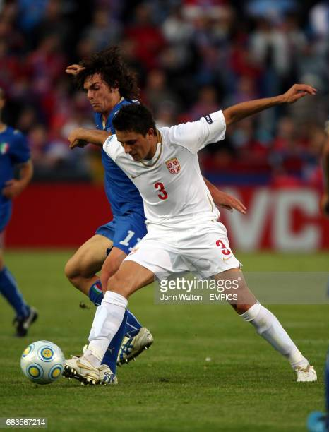 Italy's Paolo De Ceglie and Serbia's Ljubomir Fejsa battle for possession of the ball during the game