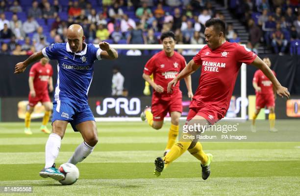 Italy's Paolo Di Canio is challenged by China's Wei Qun during the Star Sixes Tournament at The O2 Arena London