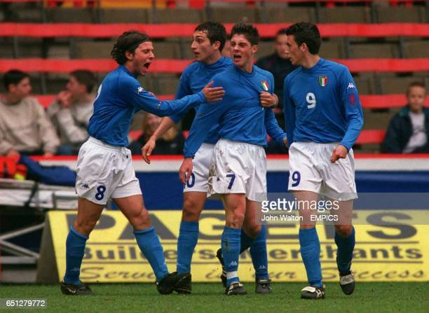 Italy's Paolo Facchinetti is congratulated by teammate's lr Alex Pederzoli Francesco Lodi and Gianpaolo Pazzini