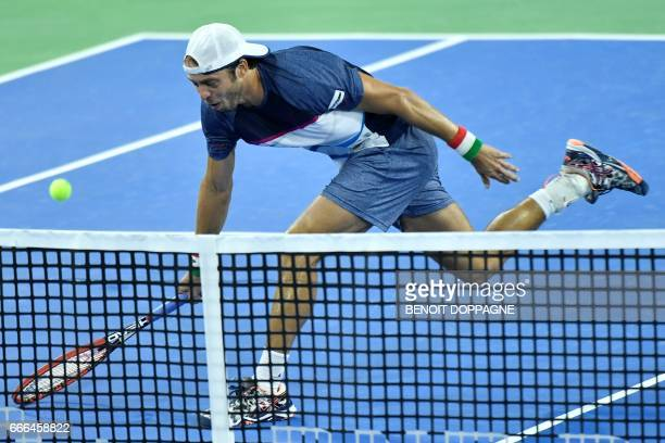 Italy's Paolo Lorenzi returns the ball during the fourth game of the Davis Cup World Group quarterfinal between Belgium and Italy on April 9 in...