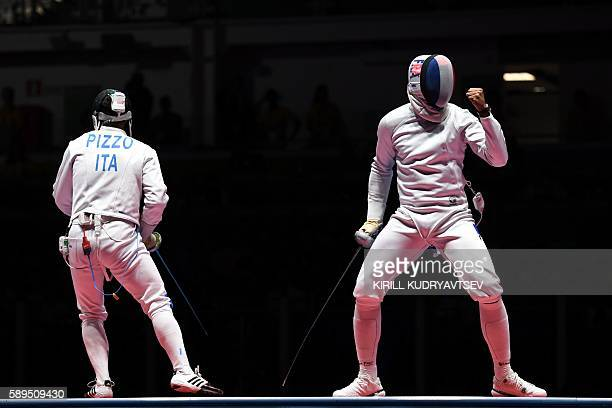 Italy's Paolo Pizzo and France's Yannick Borel react during the mens team epee gold medal bout between Italy and France as part of the fencing event...