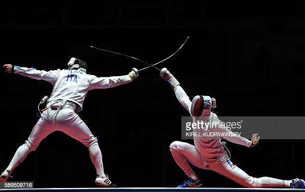 Italy's Paolo Pizzo competes against France's Yannick Borel during the mens team epee gold medal bout between Italy and France as part of the fencing...