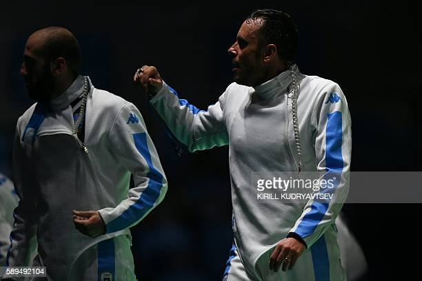 Italy's Paolo Pizzo reacts after winning the mens team epee semifinal bout between Italy and Ukraine as part of the fencing event of the Rio 2016...