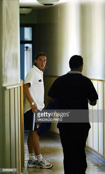 Italy's player Francesco Totti leaves the conference hall at Coverciano training camp near Florence 26 May 2004 The Italian national team is in...