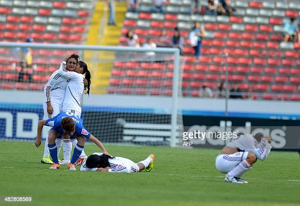Italy's player Manuela Giugliano comforts Venezuela's footballers who show their dejection after having been defeated in their FIFA U17 Women's World...