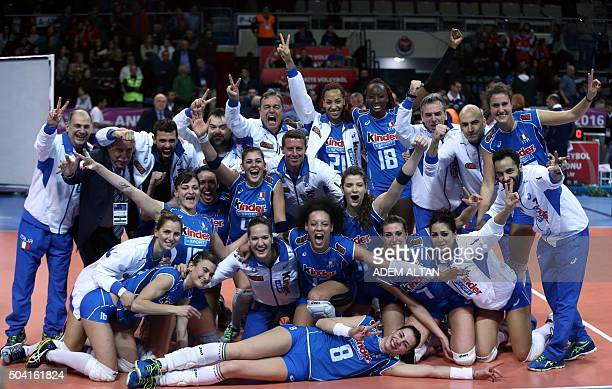 Italy's players and staff celebrate after winning the Women's European Olympic Qualification volleyball match between Italy and Turkey on January 9...
