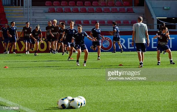 Italy's players attend a training session on the eve of the UEFA Women's European Championship Euro 2013 quarter final football match Italy vs...
