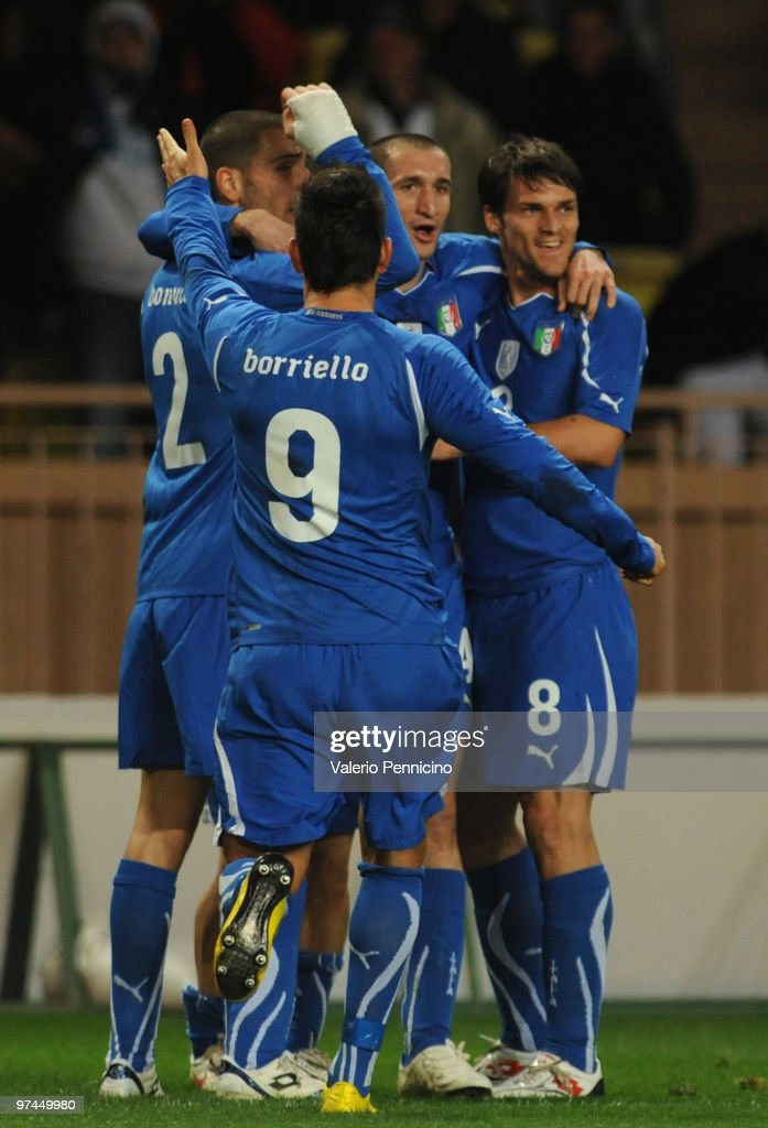 Italy's players celebrate the goal of <a gi-track='captionPersonalityLinkClicked' href=/galleries/search?phrase=Giorgio+Chiellini&family=editorial&specificpeople=605793 ng-click='$event.stopPropagation()'>Giorgio Chiellini</a> before canceling during the International Friendly match between Italy and Cameroon at Louis II Stadium on March 3, 2010 in Monaco, Monaco.