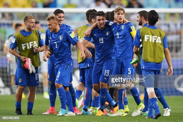 Italy's players celebrate their victory during the U20 World Cup quarterfinal football match between Italy and Zambia in Suwon on June 5 2017 / AFP...