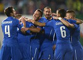 Italy's players celebrates after scoring a goal during the EURO 2016 Group H football match between Bulgaria and Italy on March 28 at the Vassil...