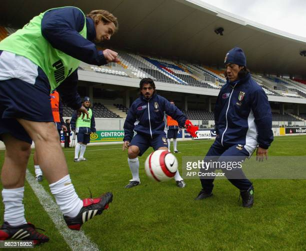 Italy's players Mauro Camoranessi Gennaro Gattuso and Massimo Ambrossini during a training session 30 March 2004 at Afonso Henriques Stadium in...