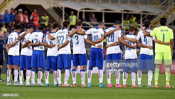 Italy's players observe a minute of silence to pay homage to the deceased of Europe's migrants crisis prior to the UEFA EURO 2016 qualifier between...