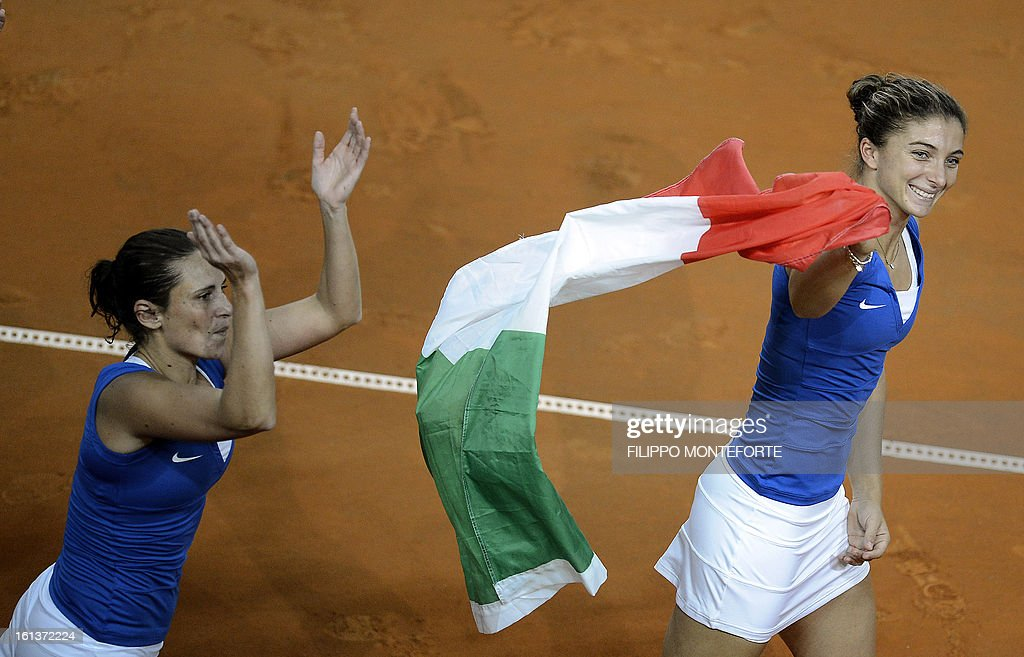 Italy's players Roberta Vinci (L) and Sara Errani celebrate after winning against US players Varvara Lepchenko and Liezel Huber during their Fed Cup tennis match in Rimini's 105 Stadium on February 10, 2013. The Italians won 6-2, 6-2 as Italy beats USA 3-2 going throught the semifinals.