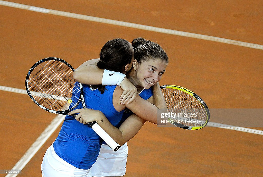 Italy's players Sara Errani (R) and Roberta Vinci celebrate after winning against US Varvara Lepchenko and Liezel Huber during their Fed Cup tennis match in Rimini's 105 Stadium on February 10, 2013. They won 6-2, 6-2 as Italy beats USA 3-2 going throught the semifinals.