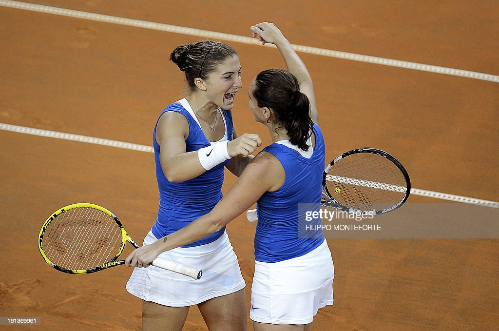 Italy's players Sara Errani (L) and Roberta Vinci celebrate after winning against US players Varvara Lepchenko and Liezel Huber during their Fed Cup tennis match in Rimini's 105 Stadium on February 10, 2013. They won 6-2, 6-2 as Italy beats USA 3-2 going throught the semifinals. AFP PHOTO / FILIPPO MONTEFORTE