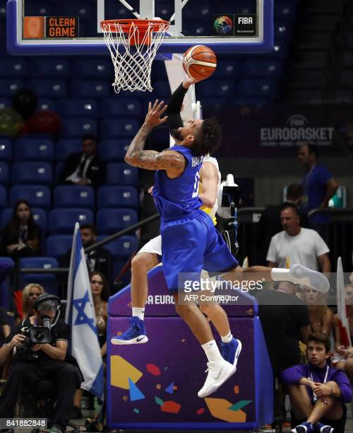 Italy's point guard Daniel Hackett drives to the basket as he is marked by Ukraine's power forward Igor Zaytsev during their FIBA EuroBasket 2017...