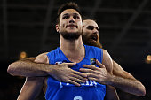 Italy's power forward Danilo Gallinari celebrates after scoring with Italy's small forward Luigi Datome during the final match of the Olympic...