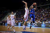 Italy's power forward Danilo Gallinari tries to score past Croatia's shooting guard Bojan Bogdanovic during the final match of the Olympic Qualifying...