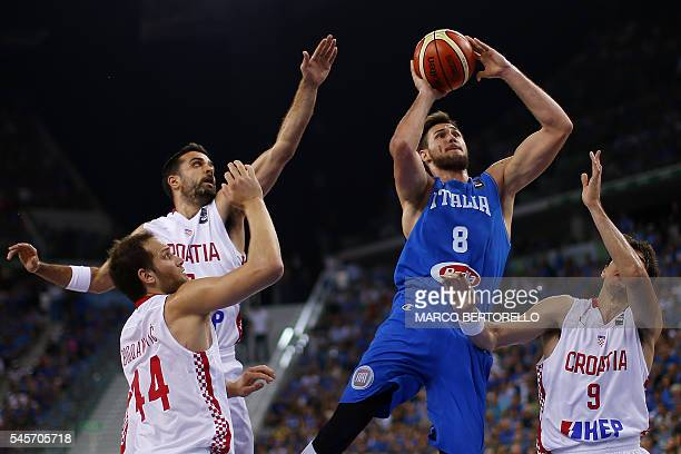 Italy's power forward Danilo Gallinari tries to score past Croatia's forward Dario Saric during the final match of the Olympic Qualifying Tournament...