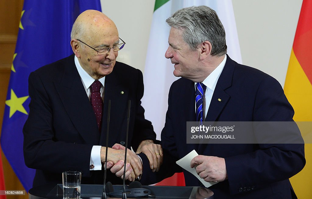 Italy's president Giorgio Napolitano (L) and German President Joachim Gauck shake hands after a press conference on February 28, 2013 at Bellevue palace in Berlin during an official visit. Napolitano has cancelled planned talks with the man bidding to unseat German Chancellor Angela Merkel after he called two of the candidates in Italian elections 'clowns.'