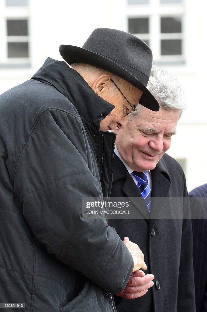 Italy's president Giorgio Napolitano (L) chats with German President Joachim Gauck on February 28, 2013 as he leaves the Bellevue palace in Berlin after their meeting during an official visit. Napolitano has cancelled planned talks with the man bidding to unseat German Chancellor Angela Merkel after he called two of the candidates in Italian elections 'clowns.' AFP PHOTO / JOHN MACDOUGALL