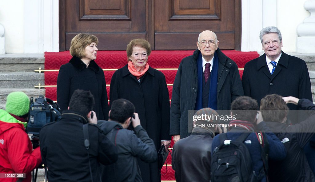 Italy's president Giorgio Napolitano (2ndR), his wife Clio (2ndL), German President Joachim Gauck and his partner Daniela Schadt pose at Bellevue palace on February 28, 2013 in Berlin during his visit in Germany. Napolitano has cancelled planned talks with the man bidding to unseat German Chancellor Angela Merkel after he called two of the candidates in Italian elections 'clowns.' AFP PHOTO / JOHN MACDOUGALL