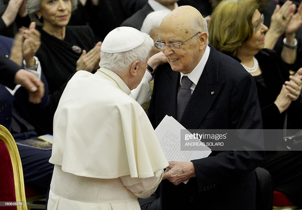 Italy's president Giorgio Napolitano (R) shakes hands with Pope Benedict XVI while arriving to attend a concert by the Orchestra del Maggio Fiorentino, directed by Indian conductor Zubin Metha, to celebrate the 84th Lateran pact's anniversary on February 4, 2013, at the Sala Nervi in Vatican city.