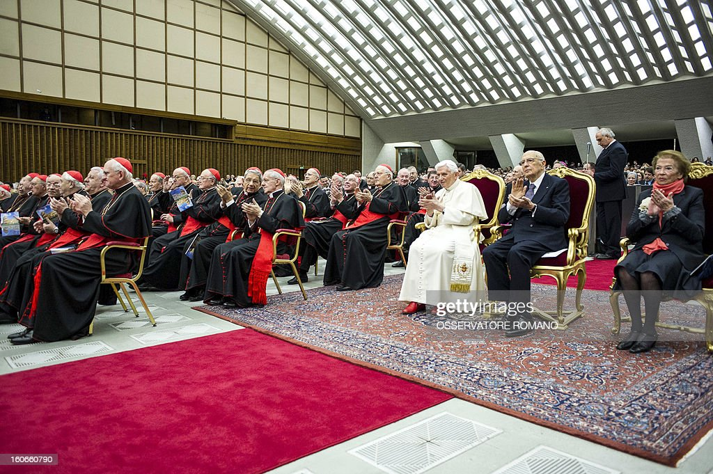 Italy's president Giorgio Napolitano (2nd R) sits flanked by Pope Benedict XVI (C) at a concert by the Orchestra del Maggio Fiorentino, directed by Indian conductor Zubin Metha, to celebrate the 84th Lateran pact's anniversary on February 4, 2013, at the Sala Nervi in Vatican city. AFP PHOTO / OSSERVATORE ROMANO'