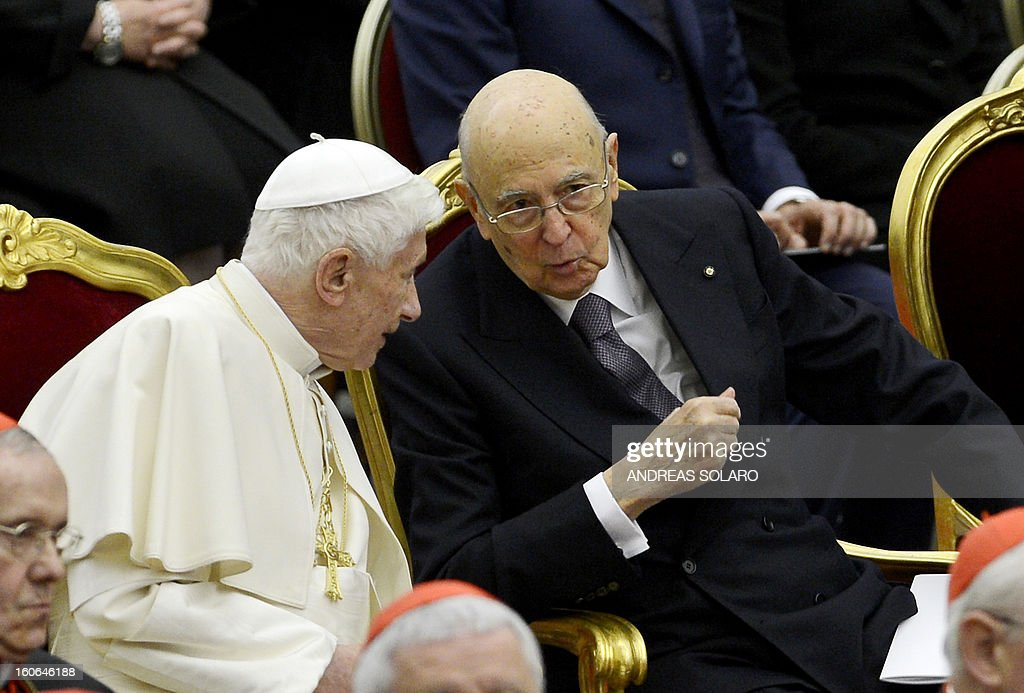 Italy's president Giorgio Napolitano (R) talks to Pope Benedict XVI while attending a concert by the Orchestra del Maggio Fiorentino, directed by Indian conductor Zubin Metha, to celebrate the 84th Lateran pact's anniversary on February 4, 2013, at the Sala Nervi in Vatican city.