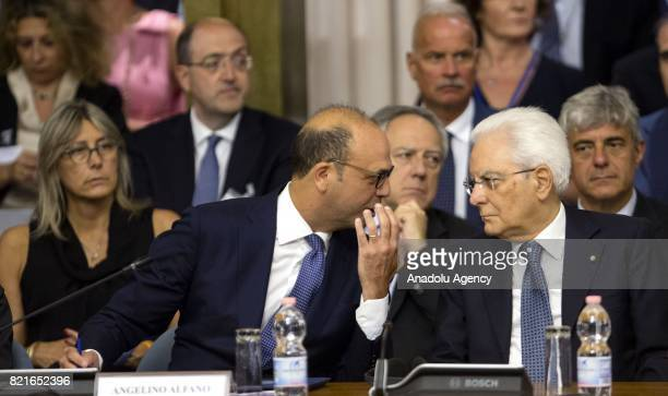 Italy's President Sergio Mattarella talks with Italian Foreign Minister Angelino Alfano during the12th Conference of the Ambassadors of Italy at the...