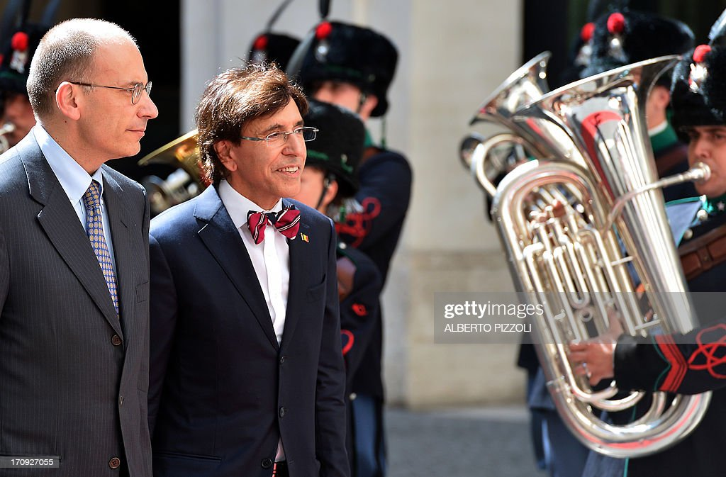 Italy's prime minister Enrico Letta (L) review honour guards with his Belgian counterpart Elio Di Rupo during their meeting at the Chigi palace on June 20, 2013. In Rome.