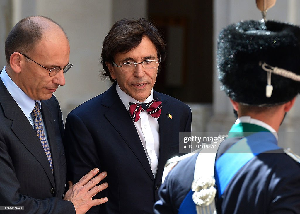 Italy's prime minister Enrico Letta (L) review honour guards with his Belgian counterpart Elio Di Rupo during their meeting at Chigi palace on June 20, 2013. In Rome. AFP PHOTO / ALBERTO PIZZOLI