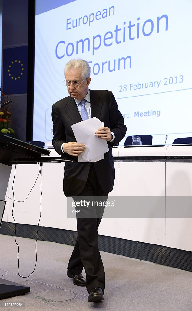 Italy's Prime Minister Mario Monti leaves the stage after his speech during the European Competition Forum held at the EU Commission headquarter in Brussels, on February 28, 2013. AFP PHOTO THIERRY CHARLIER