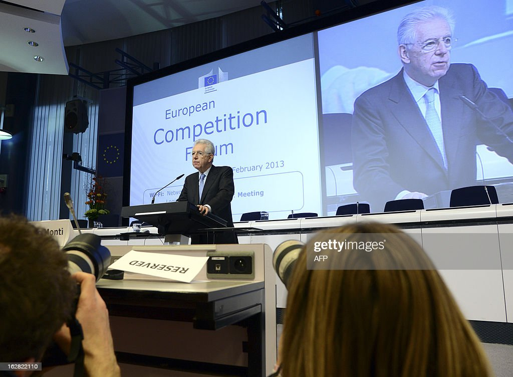 Italy's Prime Minister Mario Monti speaks during the European Competition Forum held at the EU Commission headquarter in Brussels, on February 28, 2013. AFP PHOTO THIERRY CHARLIER