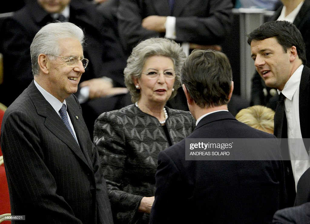 Italy's Prime minister Mario Monti (L) talks to mayor of Florence Matteo Renzi (R) before a concert by the Orchestra del Maggio Fiorentino, directed by Indian conductor Zubin Metha, to celebrate the 84th Lateran pact's anniversary on February 4, 2013, at the Sala Nervi in Vatican city.