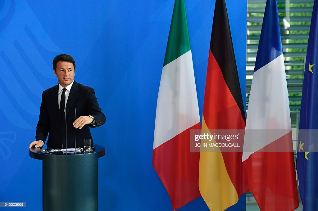 Italy's Prime Minister Matteo Renzi addresses a joint press conference with the german chancellor and French President ahead of talks following the Brexit referendum at the chancellery in Berlin, on June 27, 2016. Britain's shock decision to leave the EU forces German Chancellor Angela Merkel into the spotlight to save the bloc, but true to her reputation for prudence, she said she would act neither hastily nor nastily. / AFP / John MACDOUGALL