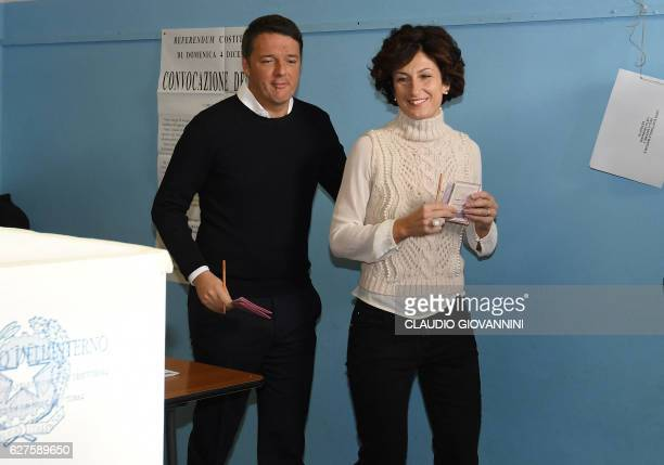 Italy's Prime Minister Matteo Renzi and his wife Agnese Landini arrive to vote for a referendum on constitutional reforms on December 4 2016 at a...