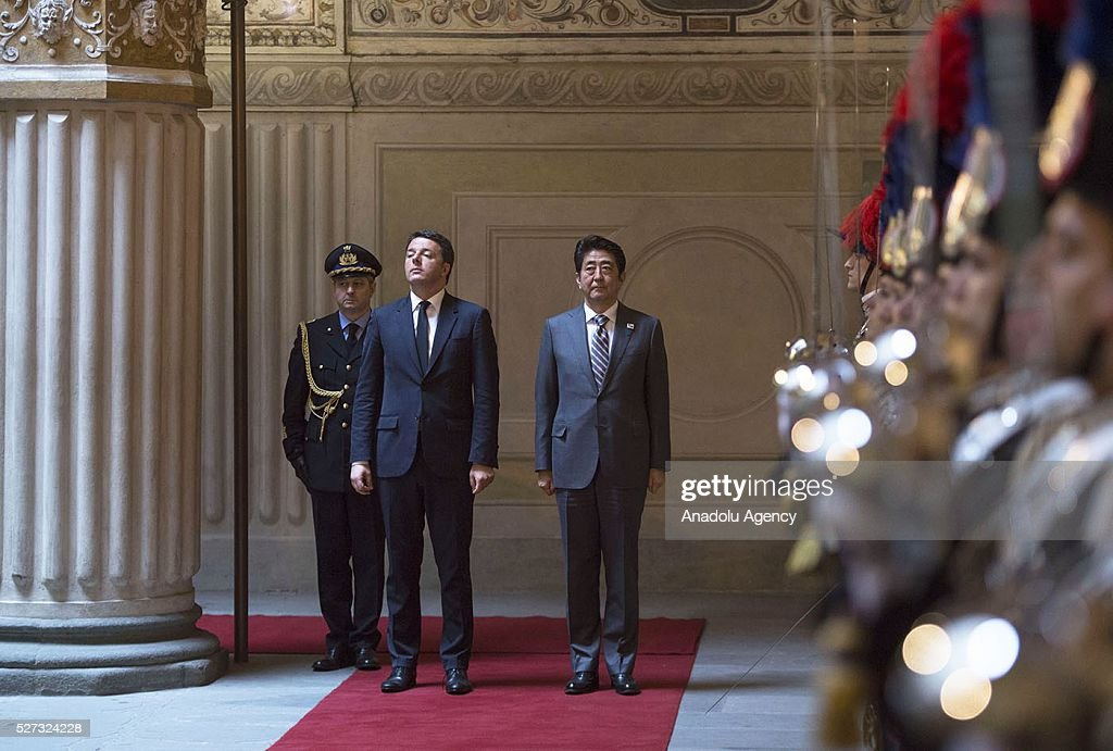 Italy's Prime Minister Matteo Renzi (R) and Japanese Prime Minister Shinzo Abe meet at Palazzo Vecchio in Florence, Italy on May 2, 2016 during Shinzo Abe's visit prior to 150th anniversary of starting of diplomatic relations between Japan and Italy.