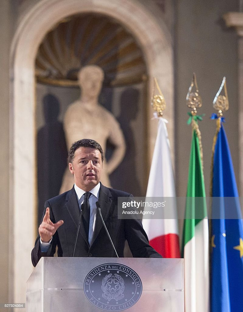 Italy's Prime Minister Matteo Renzi (C) and Japanese Prime Minister Shinzo Abe (not seen) meet at Palazzo Vecchio in Florence, Italy on May 2, 2016 during Shinzo Abe's visit prior to 150th anniversary of starting of diplomatic relations between Japan and Italy.