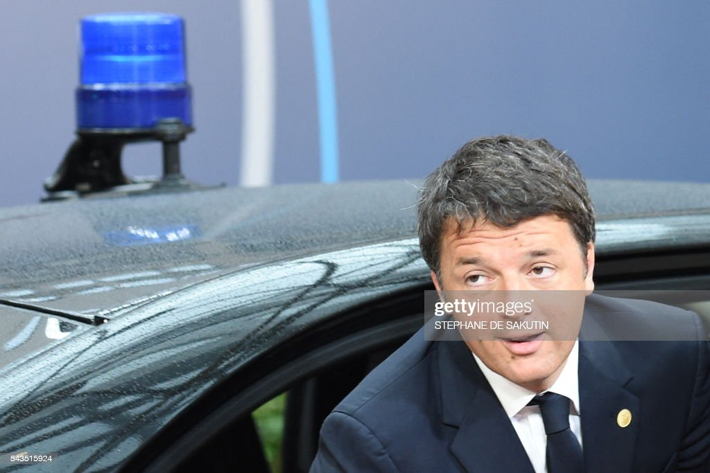 Italy's Prime minister Matteo Renzi arrives before an EU summit meeting on June 29, 2016 at the European Union headquarters in Brussels. European Union leaders will assess the damage from Britain's decision to leave the bloc and try to prevent further disintegration, as they meet for the first time without a British representative on June 29, 2016. And as the shockwaves reverberate around British politics, Scottish First Minister Nicola Sturgeon is also expected in Brussels 'utterly determined' to keep her pro-EU country in the club despite the Brexit vote. SAKUTIN