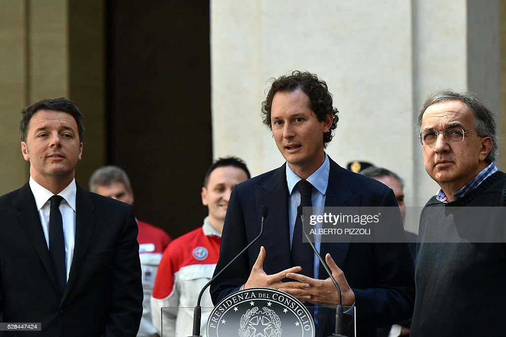 Italy's Prime Minister Matteo Renzi, FCA (FIAT) President John Elkann and CEO Sergio Marchionne are pictured during the presentation of the new FCA (FIAT) car 'Giulia' on May 5, 2016 at Chigi palace in Rome. / AFP / ALBERTO