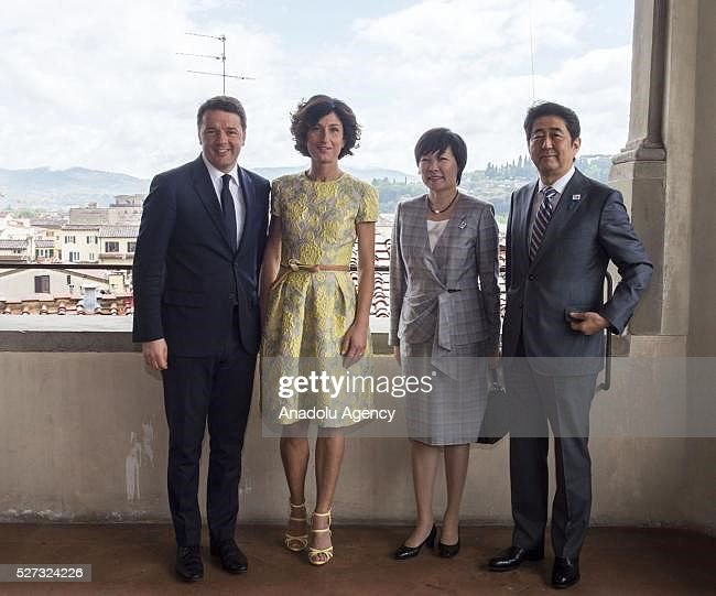Italy's Prime Minister Matteo Renzi (L), his wife Agnese Landini (2nd L), Japanese Prime Minister Shinzo Abe (R) and his wife Aike Abe (2nd R) meet at Palazzo Vecchio in Florence, Italy on May 2, 2016 during Shinzo Abe's visit prior to 150th anniversary of starting of diplomatic relations between Japan and Italy.