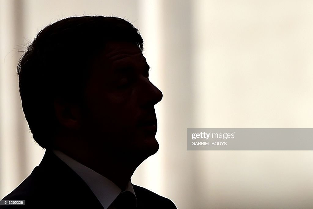 Italy's Prime Minister Matteo Renzi is silhouetted as he waits for the arrival of Israeli counterpart Benjamin Netanyahu on June 27, 2016 at the Palazzo Chigi in Rome. / AFP / GABRIEL