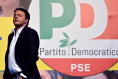 Italy's Prime Minister Matteo Renzi reacts during a campaign meeting of the Democratic Party on May 22 2014 at Piazza del Popolo in Rome AFP PHOTO /...