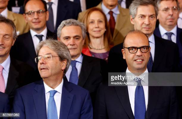 Italy's Prime Minister Paolo Gentiloni and Foreign Minister Angelino Alfano pose for a photo family after attending the Conference of Ambassadors at...