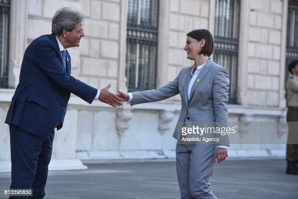 Italy's Prime Minister Paolo Gentiloni and Serbian Prime Minister Ana Brnabic shake hands during the welcoming ceremony of the Western Balkans summit...