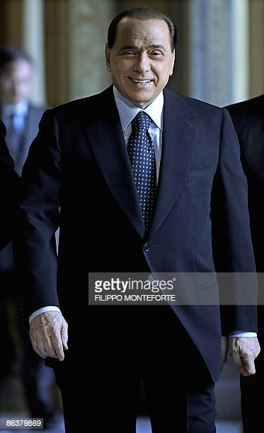 Italy's Prime Minister Silvio Berlusconi arrives for a meeting With Israel's Foreign Minister Avigdor Lieberman on May 5 2009 in Rome's Palazzo Chigi...