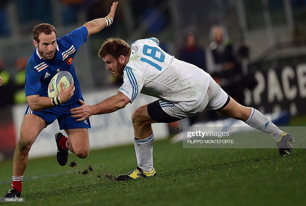 Italy's prop Lorenzo Cittadini (R) vies with France's fly-half Frederic Michalak during the Six Nations international rugby union match Italy vs France in Rome's Olimpic Stadium on February 3, 2013. Italy defeated France 23-18.