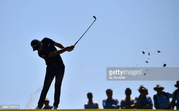 TOPSHOT Italy's Renato Paratore plays his approach shot to the first green during the second round of the PGA Championship at Wentworth Golf Club in...